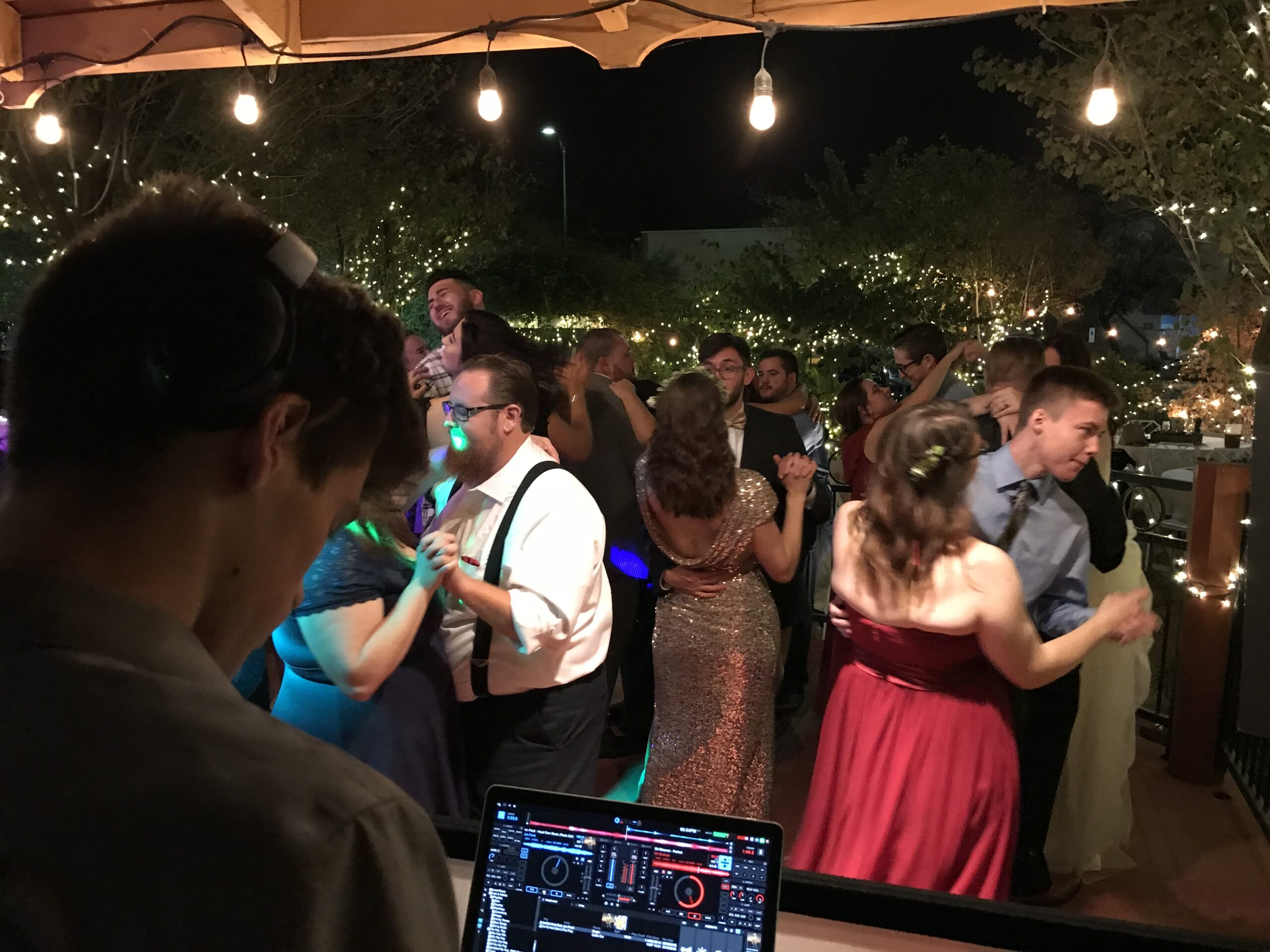 DJ Fine Plays music while crowd dances at wedding