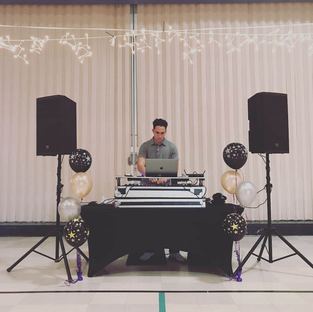 DJ set up with speakers and table
