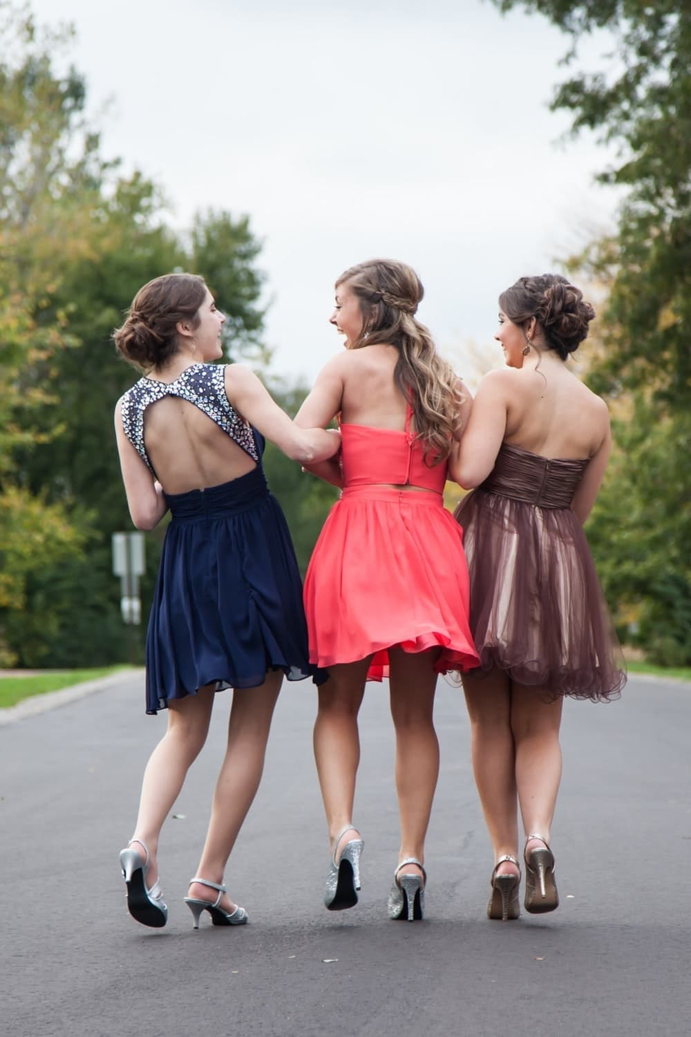 Girls arrive for prom in dresses