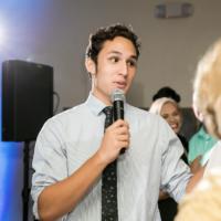 Javier Carlos DJ holds microphone