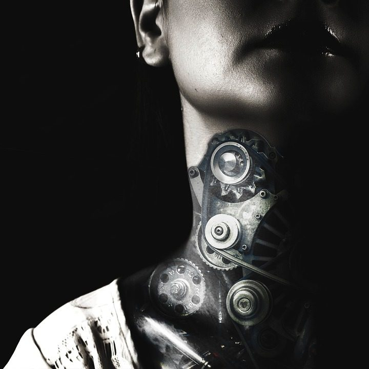 neck of a woman with gears tattooed
