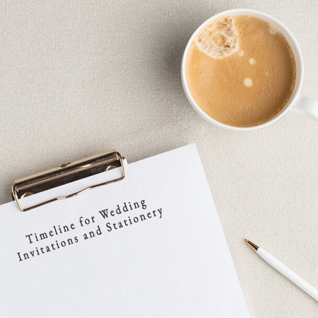 Wedding Invitation timeline on a clipboard with coffee.