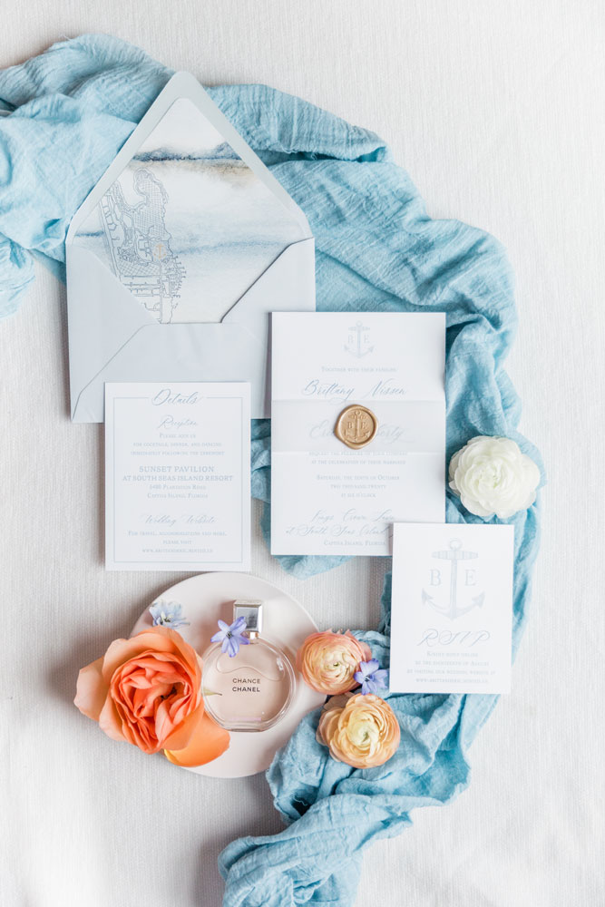 Captiva Island South Seas Island Wedding Invitation with custom island sketch, wax seal, and vellum belly band in hues of dusty blue.