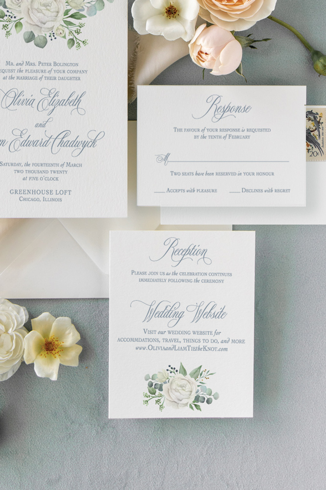 White rose wedding invitation reception card in Chicago with dusty blue background.