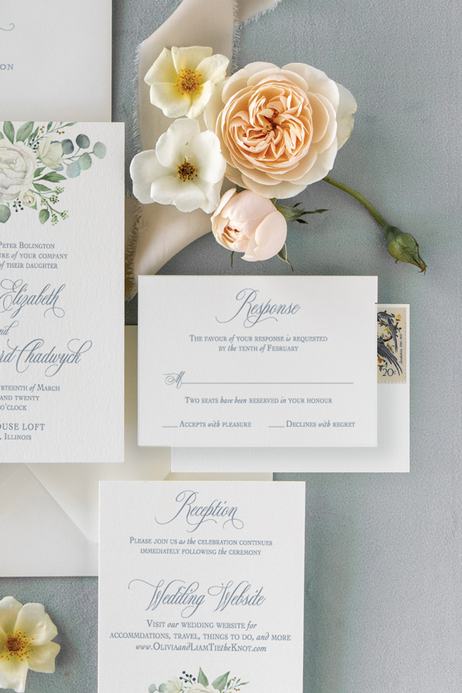 Rsvp card for Chicago Wedding with dusty blue ink and blush flowers.