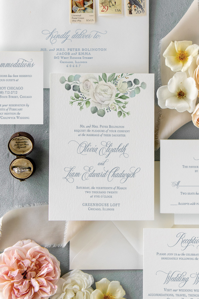 Rose and eucalyptus watercolor wedding invitation at Greenhouse Loft in Chicago with dusty blue ink.