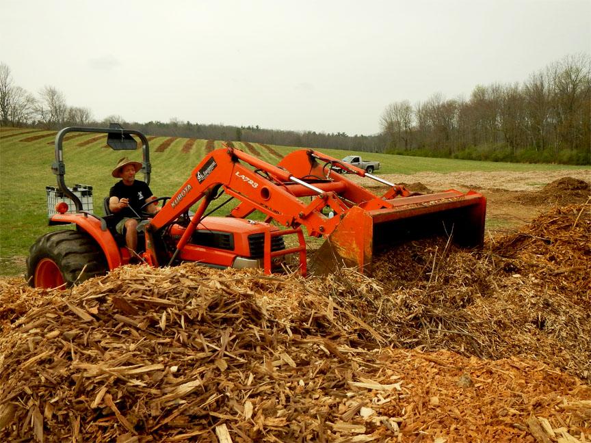Farmer Scooping Mulch