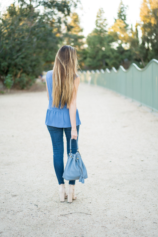 LOFT peplum blue top, J. Crew toothpick skinny jeans, Henri Bendel bucket bag, Forever 21 Sandals