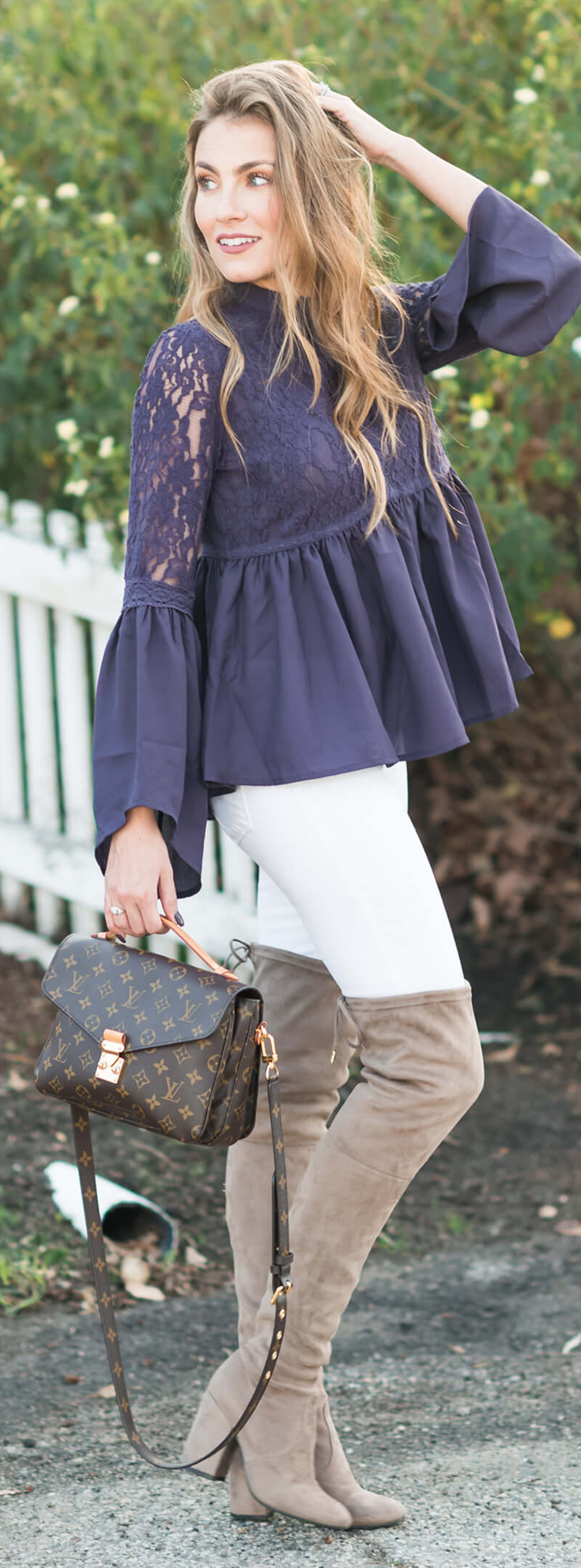 Winter Outfit I love: Blue Lace Peplum top, White Skinny Jeans, Steve Madden Over the knee boots, and Louis Vuitton Pochette Metis. Angela Lanter - Hello Gorgeous.