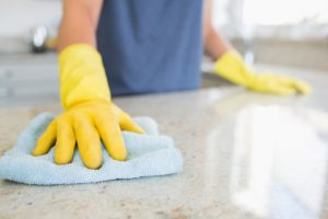 wiping the countertop