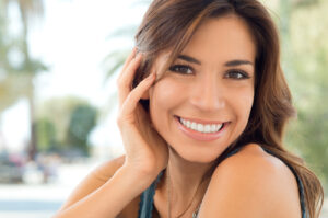 adult women smiling after orthodontic treatment