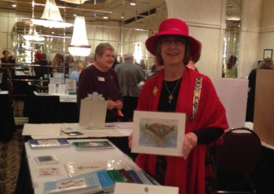 Our regent poses with the lovely Fort Dearborn drawing.