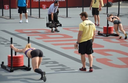 women athletes pushing weight sleds
