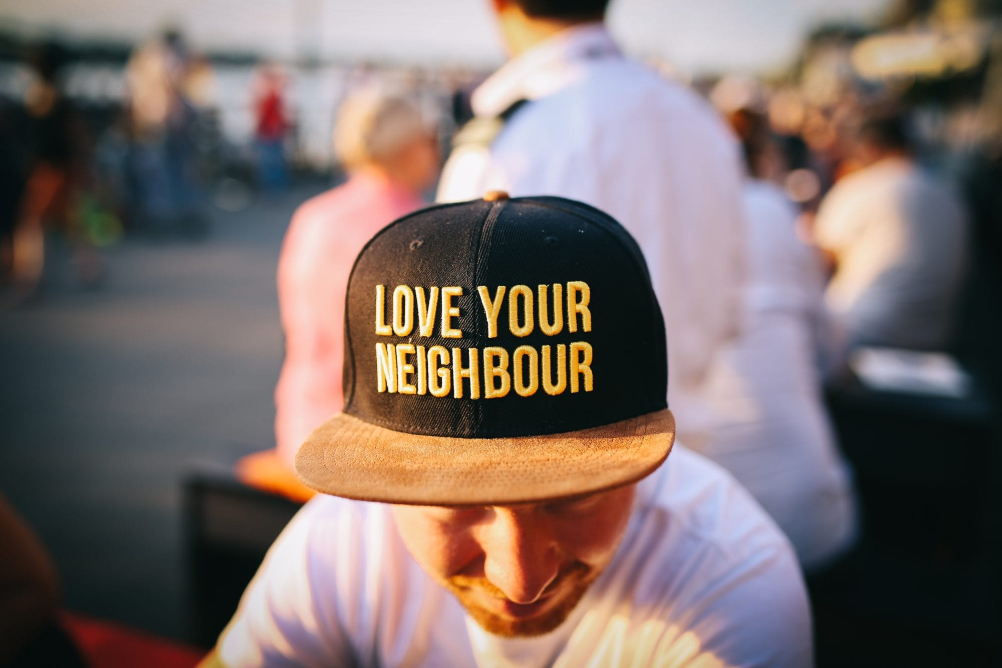 hat with love your neighbour in text