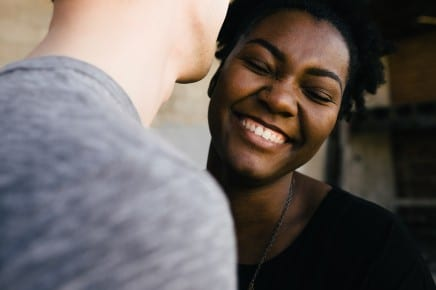 woman smiling at person
