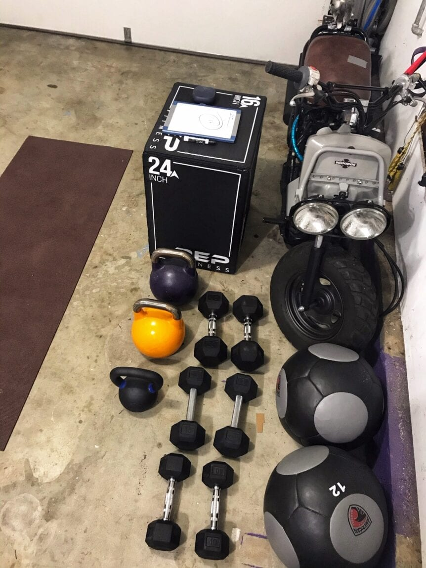 kettlebells and dumbbells in a garage