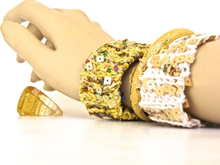 Two Bling Bam Bangles of DesigningVashti Lotus yarn and sequined strands.