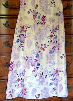 Full length silk skirt with a floral print. Lavender and cream colored background with rich gem colors in the foreground of the print.