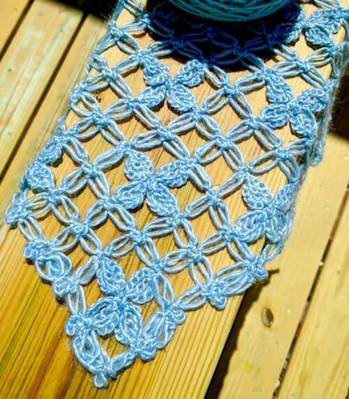 The first corner of a hanky-hem love knot mesh vest in spring sunshine.