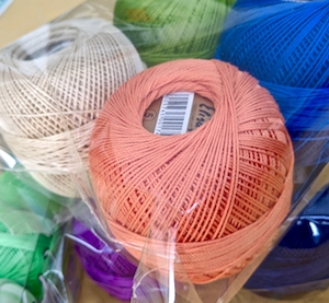 Freshly unpacked shipment of Elisa colors: beige, soft orange, medium blue, peridot green, royal purple.