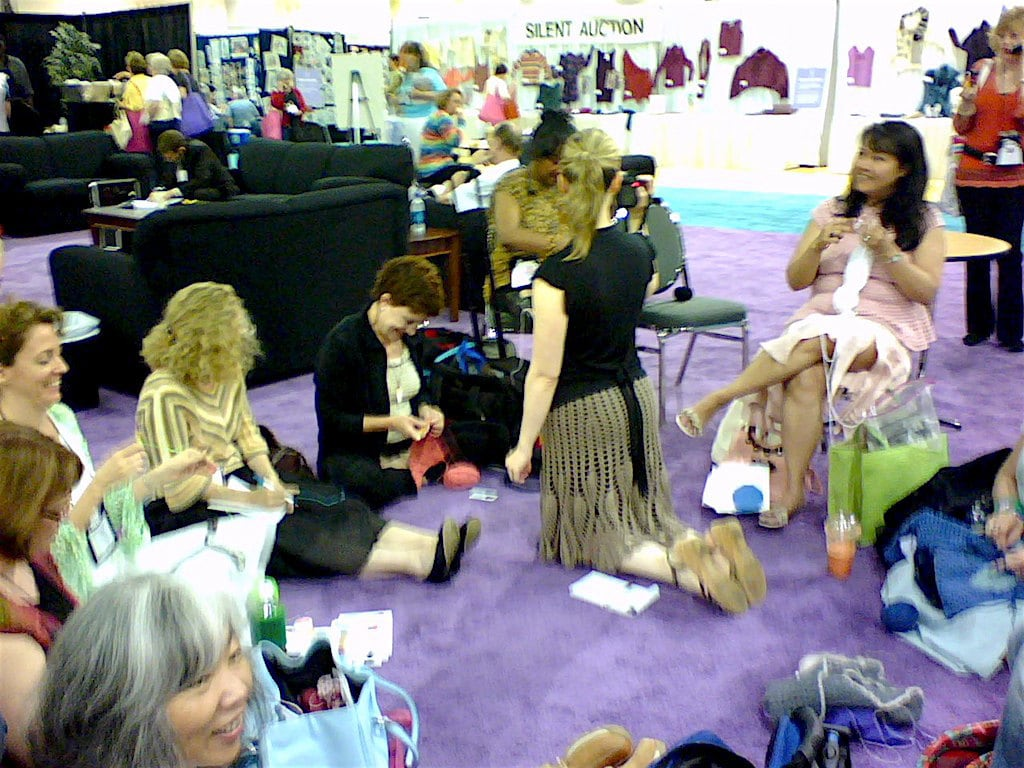 Amy O'Neill Houck's photo of Brett Bara podcasting while crochet designers protest last of crochet representation 60s-style at 2007 TNNA industry show