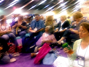 Kim Werker's photo of crochet designers & publishers during 60s-style crochet-in protest at 2007 TNNA show