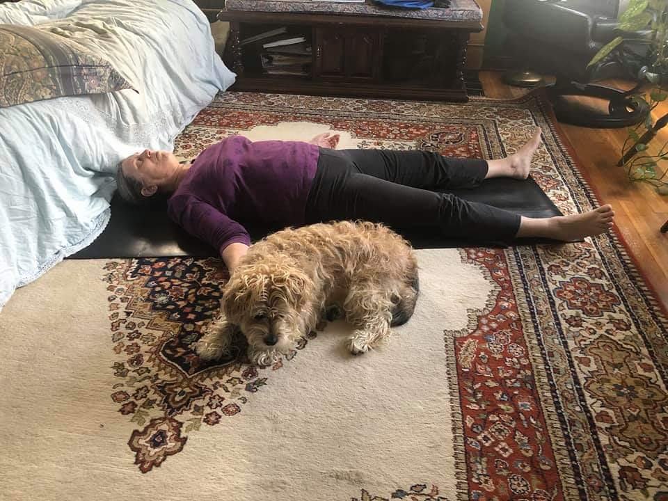 Oscar helps Bobbi Gibbons is Savasana