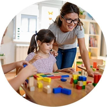 women and daughter with building blocks