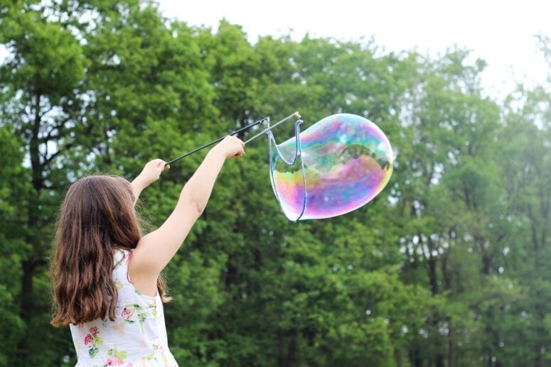 Girl playing with bubble
