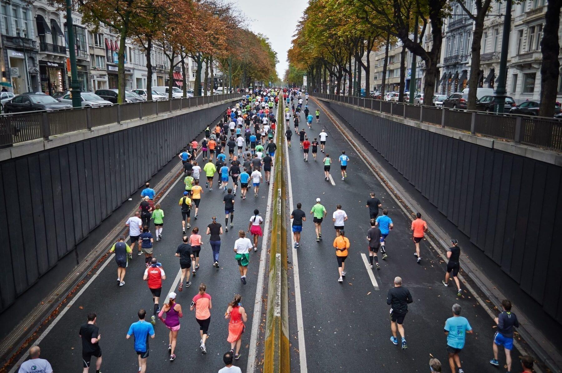 People running along street