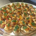 Coronation chicken on toasts with mango chutney topped with cilantro