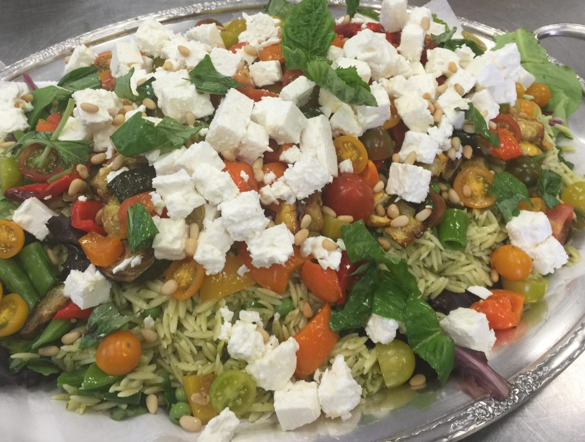 Pesto orzo with roasted vegetables, feta cheese and toasted pine nuts