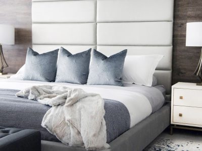 In the bedroom design of this Ajax home, the full-height headboard made of vant system panels is another example of a custom look created without spending a lot of money