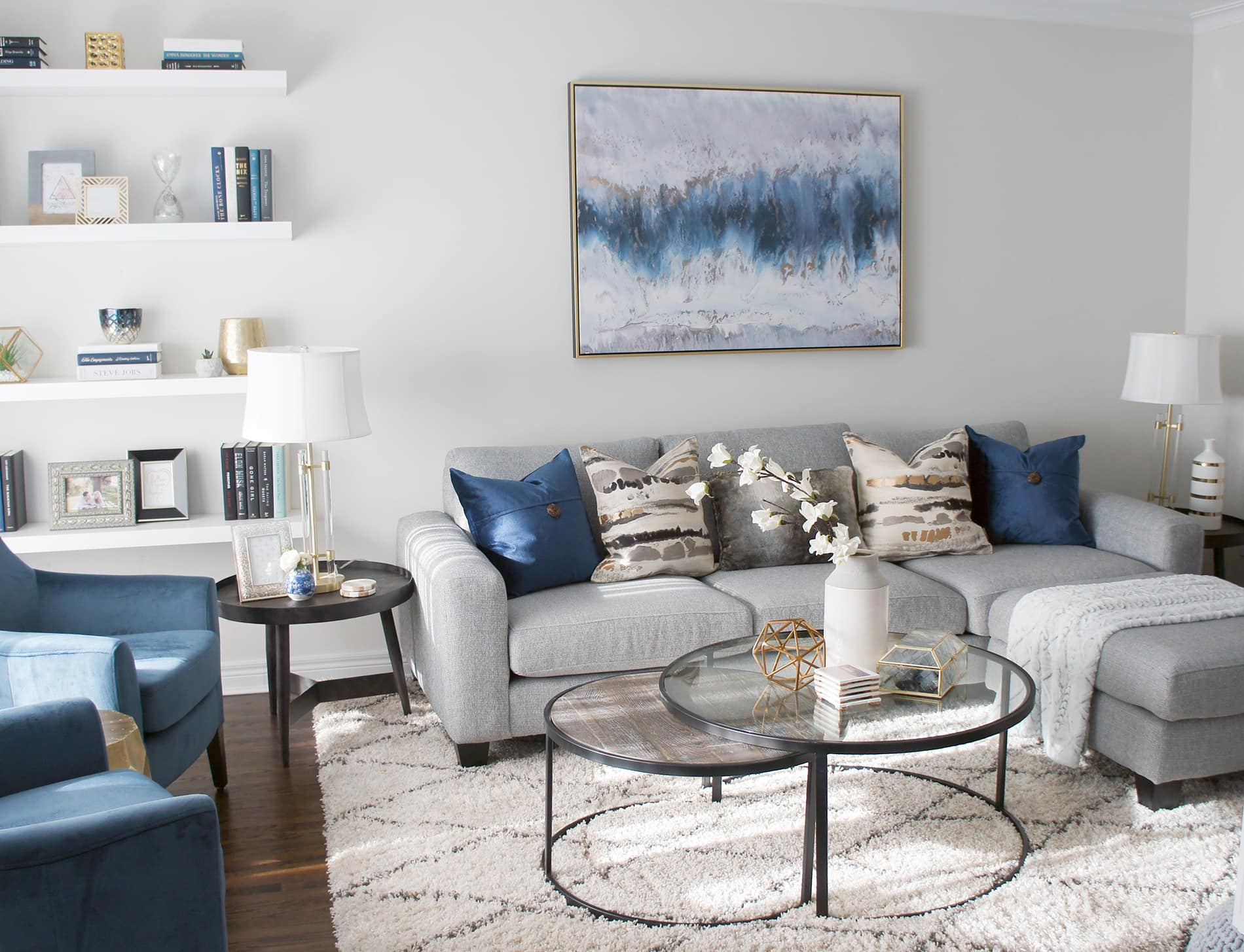 This client is a fan of colour, so we built up rich blue tones through the artwork, pillows and accessories in this living room
