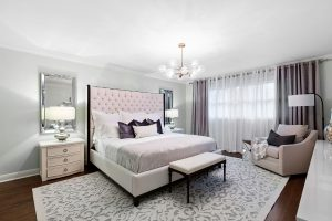 Sumptuous texture, built up with bedding fabrics, a rug and drapery