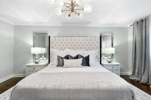 In the bedroom, the fabrics and lighter colour create a high-end, sumptuous feel