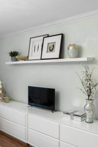 A simple floating shelf with a curated collection of display items