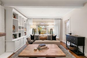 We used the pillows to add a pop of orange, plus built up texture with the tribal patterned pillows and the carpet