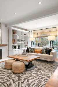 Texture added from the patterned rug and woven ottomans