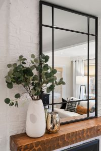 The mirror on the mantle adds wonderful height and reflection