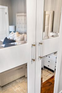 Glass-panelled doors leading into the bedroom