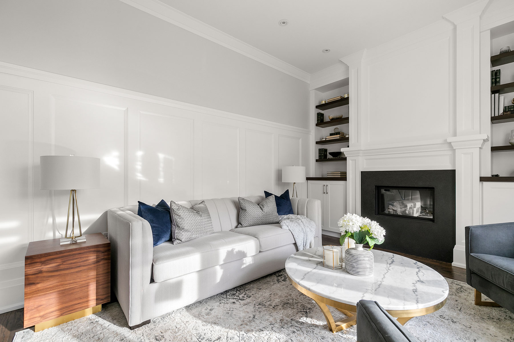 For this family room design, we chose a sectional with durable fabric and added extra seating with the leather ottoman and swivel chairs