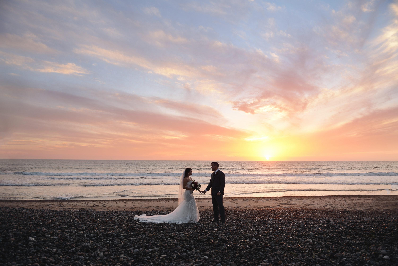 bride and groom on beach, wedding sunset beach photo
