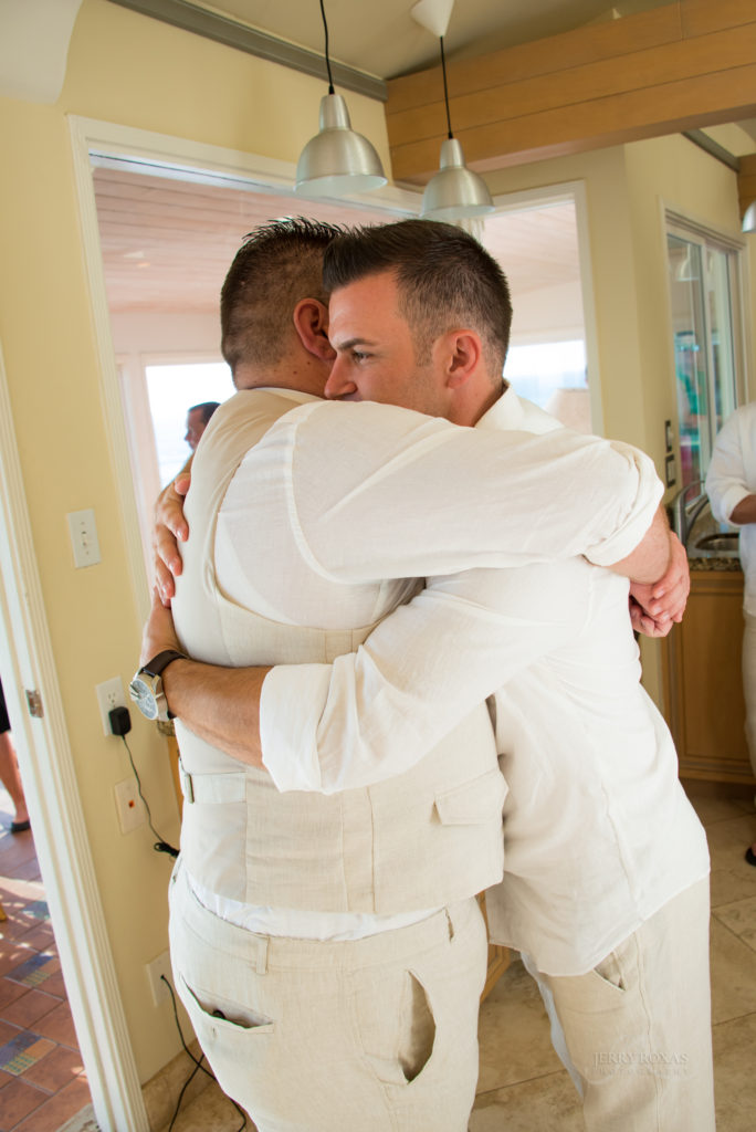 tender moment with groom and groomsman