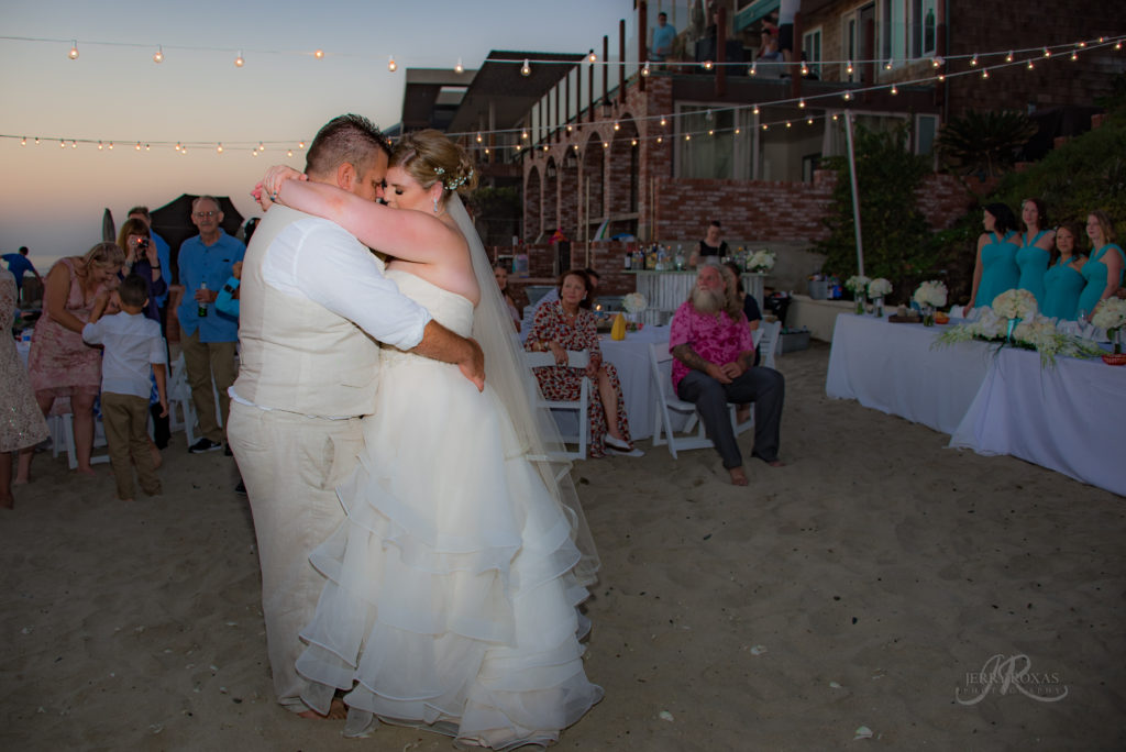 bride and groom dancing, beach wedding