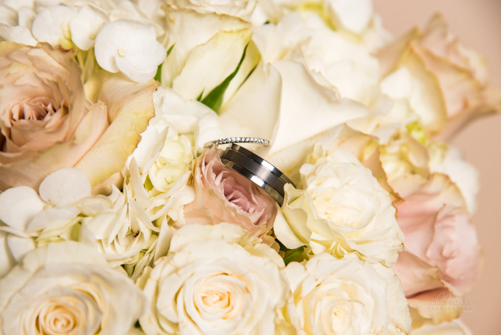 ivory wedding flowers, wedding rings with bouqet