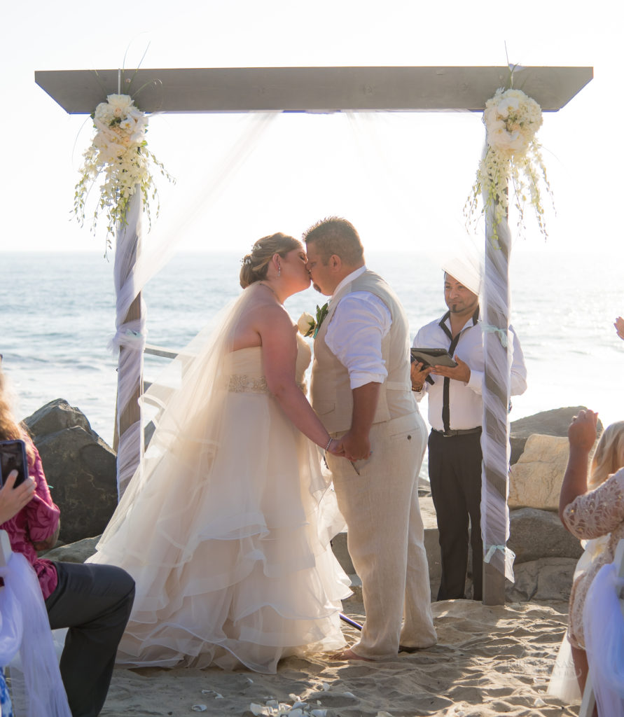 bride and groom first kiss, beach wedding, toes in sand wedding