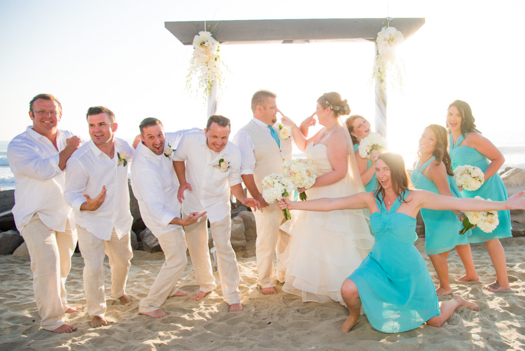 beach wedding, bridal party goofing off