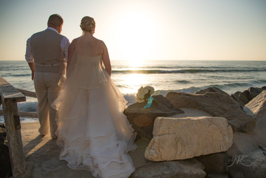 bride and groom sunset beach photo