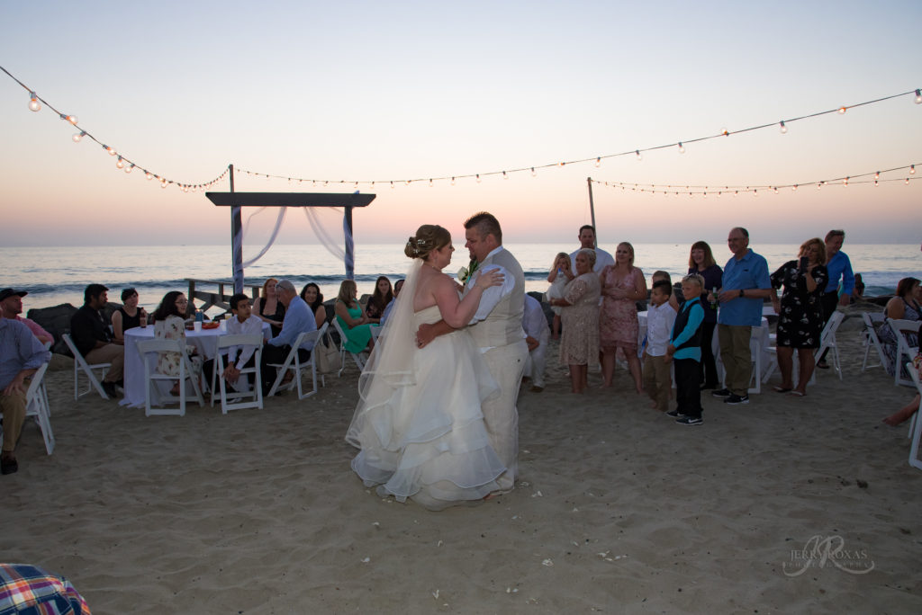 bride and groom first dance, beach wedding, toes in sand wedding